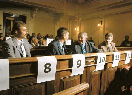 ??  ?? Some of the Boeremag members accused of treason appear in the Palace of Justice, where the Rivonia trialists faced death 38 years ago. Among the ammunition confiscated at their arrest was a bucket filled with commercial explosives, apparently meant for...