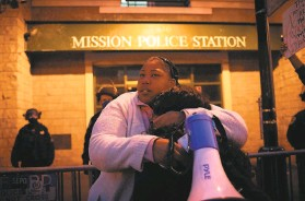 ?? Sarahbeth Maney / Special to The Chronicle ?? A fellow protester embraces Talika Fletcher (left), the sister of Roger Allen, a Black man killed by Daly City police under hazy circumstances this month.