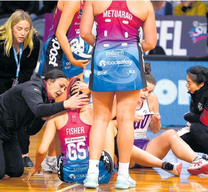 ?? Photo / Getty Images ?? Southern Steel star George Fisher gets attention after a collision with Elle Temu (right).