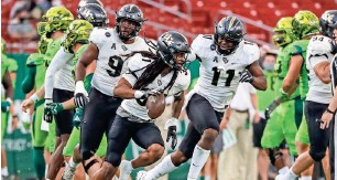 ?? MIKE WATTERS / USA TODAY SPORTS ?? Central Florida defensive back Aaron Robinson (with football) could be a player the Packers take a look at late in the first round.