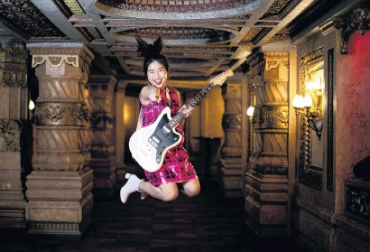 ?? PHOTO: THE NEW ZEALAND HERALD ?? Jumping for joy . . . Young singer and songwriter Venice Qin, whose mother has booked Auckland's Civic Theatre to showcase the teen's talent.