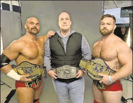 """?? Courtesy of Michael Dockins ?? The """"Gimmick Attorney"""" Michael Dockins, a lifelong wrestling fan, is pictured with wrestler clients Dax Harwood, left, and Cash Wheeler of All Elite Wrestling."""