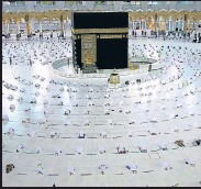 ?? AFP ?? Worshippers in socially distanced positions perform a prayer in the Grand Mosque complex in Mecca, Saudi Arabia.