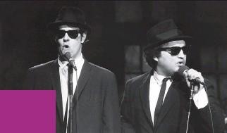 ?? AL LEVINE/NBC ?? Dan Aykroyd as Elwood Blues, left, and John Belushi as Jake Blues perform as the Blues Brothers on Saturday Night Live in November 1978.