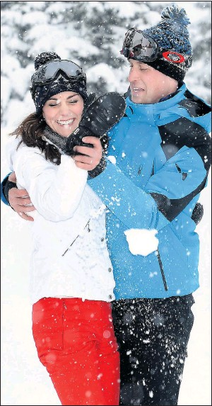 ??  ?? Wills and Kate grapple playfully after she landed him with a snowball to the chest