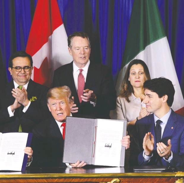 ?? SEAN KILPAT RICK / THE CANADIAN PRESS FILES ?? Then-foreign affairs minister Chrystia Freeland with Prime Minister Justin Trudeau and U. S. President Donald Trump at the signing ceremony for the new United States-mexico- Canada Agreement held in Buenos Aires in 2018.