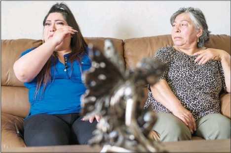 ?? (AP) ?? Oriana Hernandez, (left), and Mercedes Ramos become emotional at their home while talking about Jerry Ramos, 32, in Watsonville, Calif., Sunday, June 6. Hernandez's boyfriend and Mercedes Ramos' son Jerry Ramos died Feb. 15 at age 32, becoming not just one of the roughly 600,000 Americans who have now perished in the outbreak but another example of the virus's strikingly uneven and ever-shifting toll on the nation's racial and ethnic groups.