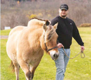 ??  ?? Two years sober, veteran Adam Halloran now enjoys healthier pastimes: gardening, pottery, and spending time at the barn.