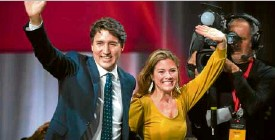 ?? —AFP ?? FRESH TERM Prime Minister Justin Trudeau celebrates with his wife Sophie after winning a second term.