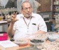 ?? R. ASHOK ■ ?? Ready solution: R. Vasudevan, who came up with the plastic road process.