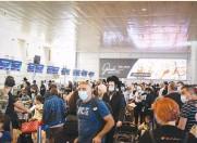 ??  ?? TRAVELERS WAIT in line at Ben-Gurion Airport last week. (Flash90)