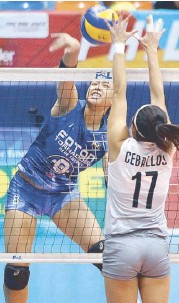 ??  ?? Foton's Eya Laure faces Generika's Mae Ceballos in a one-on-one duel at the net.