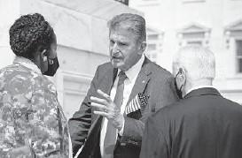 ?? J. SCOTT APPLEWHITE/AP ?? Sen. Joe Manchin, D-W.Va., center, shown Saturday with Rep. Sheila Jackson Lee, D-Texas, and Rep. Mike Thompson, D-Calif., has said that President Joe Biden's $3.5 trillion spending plan will have to be pared back.
