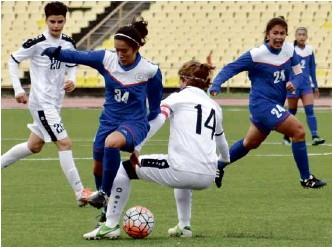 ??  ?? Sara Castañeda maneuvers past a Tajikistan defender as skipper Patrice Impelido (24) makes a flanking move in support. At right is Claire Lim (2). Main picture: The team celebrates its qualification for the 2018 Asian Cup in Jordan.
