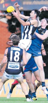 ?? Picture: Jackson ?? Swan Tony Notte flies high to mark in front of East Perth's Bradley Fullgrabe. Flindell
