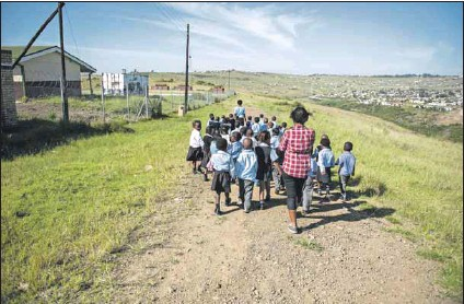 ?? Photo: Madelene Cronje ?? Long road ahead: The Eastern Cape education department said all its grade one learners had been placed in schools, though some were placed only two weeks ago.