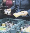 ??  ?? Food banks have seen calls for their help dou­ble