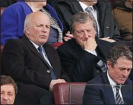 ??  ?? plenty to ponder: Roy Hodgson (centre) is lost in thought at Wembley with Greg Dyke