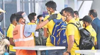 ?? B. VELANKANNI RAJ ■ ?? Safety first: Chennai Super Kings captain M.S. Dhoni gets a thermal scan at the Chennai airport on Friday.