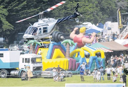?? PHOTOS: GERARD O'BRIEN ?? Up and away . . . A HeliOtago helicopter lifts off from the Brighton Domain for a scenic flight at the Brighton Gala Day yesterday. Right: Aaron Horwood (8) has a bounce into the sky.