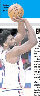 ?? —AFP ?? Joel Embiid was on target against the Nets.