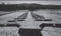 ?? MARK RALSTON/AFP/GETTY IMAGES ?? Boat docks lie on the dried-up lake bed of Huntington Lake, a reservoir in Fresno County, California, which is at only 30 per cent capacity as a severe drought affects the state.