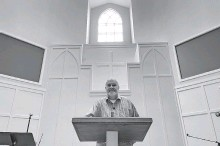 ?? [AP FILE PHOTO] ?? The Rev. Jim Conrad stands Feb. 18 in the Towne View Baptist Church in Kennesaw, Georgia.