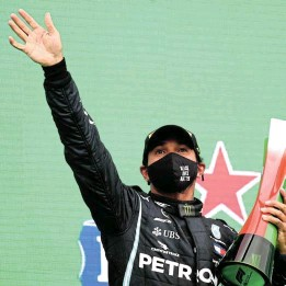 ?? Joe Portlock/Getty Images ?? Track triumph: Race winner Lewis Hamilton of Great Britain and Mercedes GP celebrates his record-breaking 92nd race win during the F1 Grand Prix of Portugal at Autodromo Internacional do Algarve on Sunday in Portimao, Portugal. (See report on Page 16) /