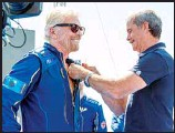 ??  ?? Virgin Galactic founder Richard Branson (left), receives his astronaut wings from Canadian astronaut Chris Hadfield after his flight to space from Spaceport America near Truth or Consequences, New Mexico, July 11. (AP)