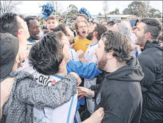 ?? PHOTO: Justin Jenvey ?? WHAT HOODOO?: Players and supporters erupt in joy when Savoy broke through for its maiden Cup victory last year.