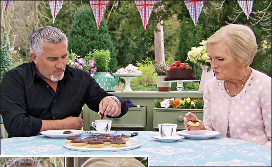 ??  ?? To dunk or not to dunk: Paul Hollywood dips a Jaffa Cake into his tea – much to the chagrin of his co-star Mary Berry