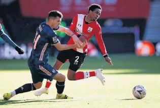 ?? PHOTO: VIA REUTERS ?? Block solid . . . Arsenal's Granit Xhaka (left) tussles with Southampton's Kyle WalkerPeters in their FA Cup fourthround game in Southampton yesterday. Holder Arsenal bowed out in a 10 loss.