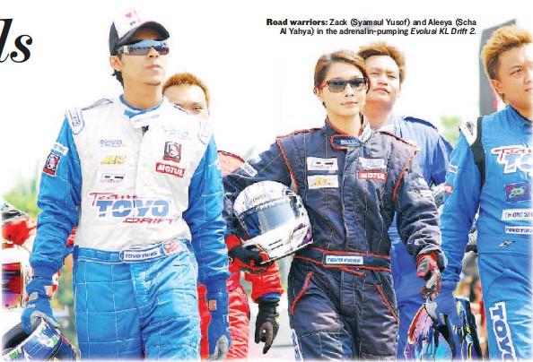 ??  ?? Road warriors: Zack (Syamsul Yusof) and Aleeya (Scha Al Yahya) in the adrenalin-pumping Evolusi KL Drift 2.