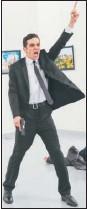 ?? BURHAN OZBILICI / ASSOCIATED PRESS ?? Gunman Mevlut Mert Altintas gestures after shooting the Russian ambassador to Turkey, Andrei Karlov, at a photo gallery in Ankara, Turkey, on Monday.