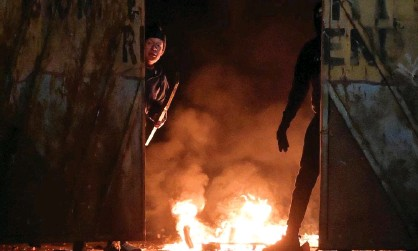 ?? Photograph: Charles McQuillan/Getty Images ?? Fires at the Peace Gate in Belfast on 7 April after youths attacked police and petrol-bombed a bus.