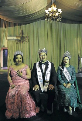 ??  ?? Shumeez Scott, 19, right, is the first South African woman with Down syndrome to land a permanent contract with a model agency. She has also won an international modelling competition. Shumeez and her mom, Bahia Janodien, are developing a non-profit organisation for young people with special needs. Participants in a fundraiser pose backstage in Fordsburg, Joburg.