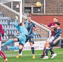 ??  ?? Raith's Lewis Vaughan launches another attack