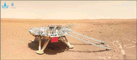 ?? (AP) ?? In this image released by the China National Space Administration (CNSA) on Friday, June 11, 2021, the landing platform with a Chinese national flag and outlines of the mascots for the 2022 Beijing Winter Olympics and Paralympics on Mars is seen from the rover Zhurong. China on Friday released a series of photos taken by its Zhurong rover on the surface of Mars, including one of the rover itself taken by a remote camera.