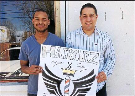 ?? JENNIE GREY — JGREY@DIGITALFIRSTMEDIA.COM ?? Casey James (left) and Lamont Washington hold up a handmade sign in front of TrueCutz, their barbershop-in-progress on Jefferson Street.
