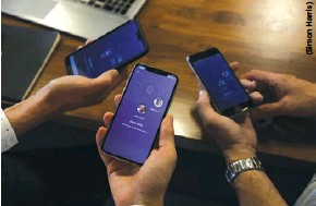 ??  ?? British mobile-only bank Koto executives test its smartphone app. The Ukrainians who founded Koto in the United Kingdom want to make it as similar to Ukrainian Monobank as possible, leaving, for example, most of the style untouched.