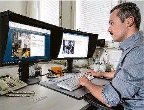?? Foto: Marijan Murat/dpa ?? Michael Aschenbrenner, Super Recogniser des Polizeipräsidiums Stuttgart, betrachtet Fahndungsbilder.
