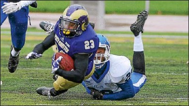 ?? PHOTO BY SCOTT ROWAN ?? West Chester's Janel Elder carries for a first down as he is brought down by Cheyney's Marvin Easter.