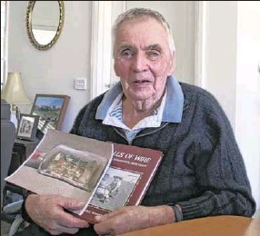 ??  ?? POW MEMORIES: Nagambie farmer Max Perry with his Joyce Hammond 'Walls of Wire' book of memories of Graytown and the Prisoner of War camps at Tatura, Rushworth and Murchison.