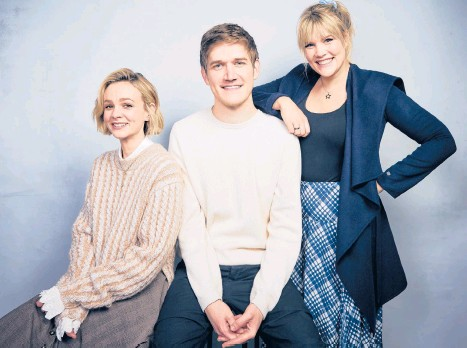 ?? TAYLORJEWE­LL/INVISION ?? Carey Mulligan, from left, Bo Burnham and Emerald Fennell at the Sundance Film Festival in January 2020.