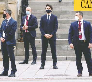 """?? BLAIR GABLE / REUTERS ?? Prime Minister Justin Trudeau waits to cross the street in Ottawa before a news conference on Tuesday. Trudeau's promises of """"modest, short-term deficits"""" have flown straight out the window, writes John Ivison."""