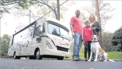 """?? BOB BROWN/TIMES-DISPATCH ?? The Collins family— Dan, 10-year- old Noah, Liz and Rufus— stood in front of their newRV on Oct. 26. They left Richmond on Nov. 13 to travel around the country, visiting national parks, friends and family. """"We needed to shake things up,"""" Liz said."""