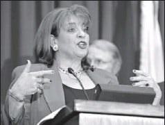 ?? By Rick Wilson, AP ?? Center of prosecution: Florida state attorney Angela Corey announces Wednesday that George Zimmerman will be charged with second-degree murder.
