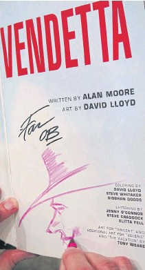 ??  ?? PENCIL-THIN MOUSTACHE: David Lloyd autographs a copy of his graphic novel for a fan at his Chulalongkorn University exhibition by spontaneously drawing a crayon sketch of the story's anarchistic V character.