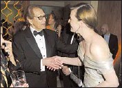"?? Jeff Kravitz FilmMagic ?? 2011: Then-HFPA President Philip Berk and Milla Jovovich. A Berk memoir admitted ""protectionism."""