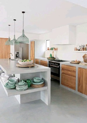 ??  ?? KITCHEN Solid timber drawer fronts and cupboard doors add warmth and a traditional farmhouse feel to the modern concrete kitchen cabinetry (top right). The minty green crockery is mirrored in the pendant, bought in Weylandts in South Africa. >